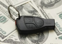Car Insurance Blog with key remote on money